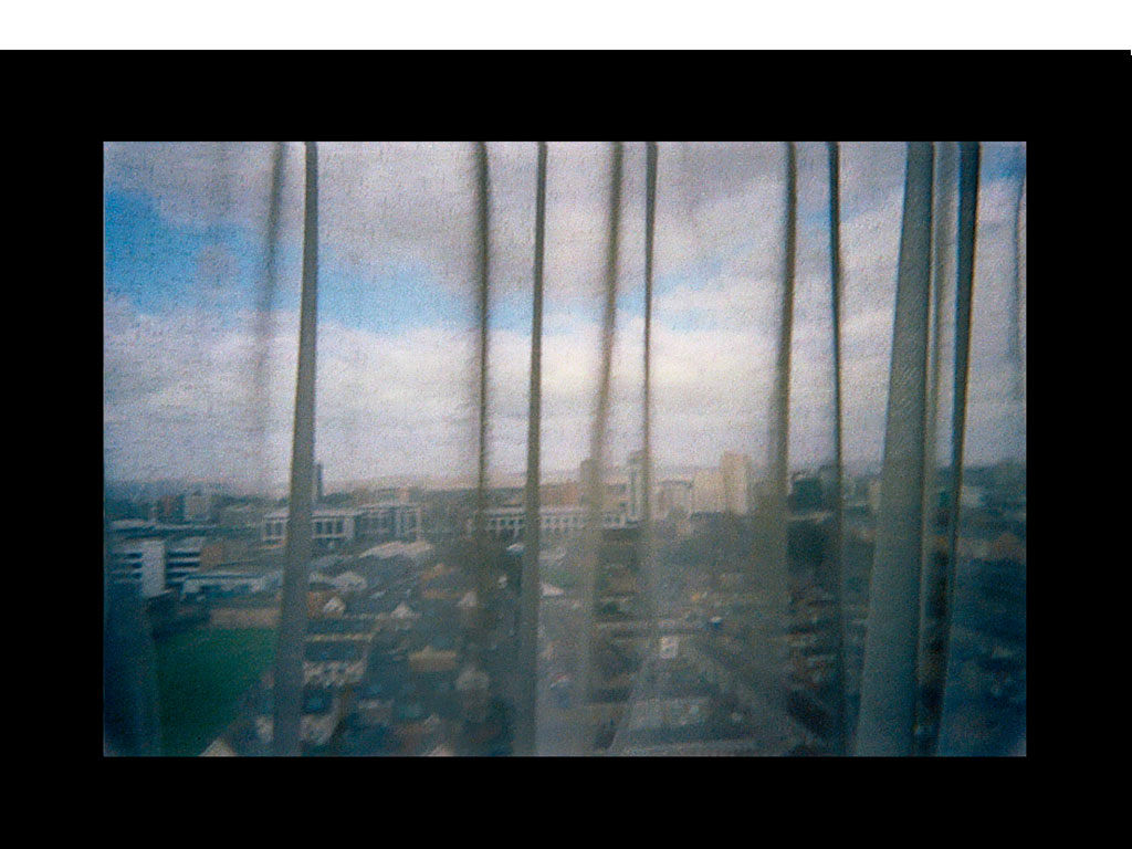 <i><b>Image:</b></i> a resident's view from <i>Different Storeys</i>, a participatory photography project produced by Anna Heinrich & Leon Palmer with Residents of Loudoun House and Nelson House, Butetown, Cardiff, 2012 © Heinrich & Palmer and CCHA