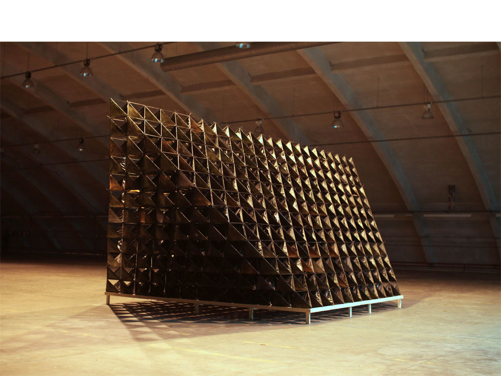 <b><i>Image:</i></b> <i>Blue Bell Hangar</i>, an experimental sculpture by New British Art installed in the Blue Bell Hangar, St Athan former military airbase, Vale of Glamorgan, 2011 © New British Art