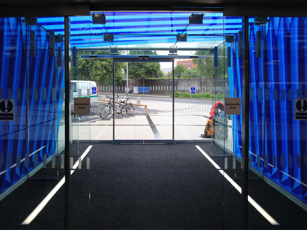 <i><b>Image:</b></i> <i>Fold</i>, a screen-printed enamel application to the glass cube entrance way of @Loudoun Square, Anna Heinrich & Leon Palmer, 2012