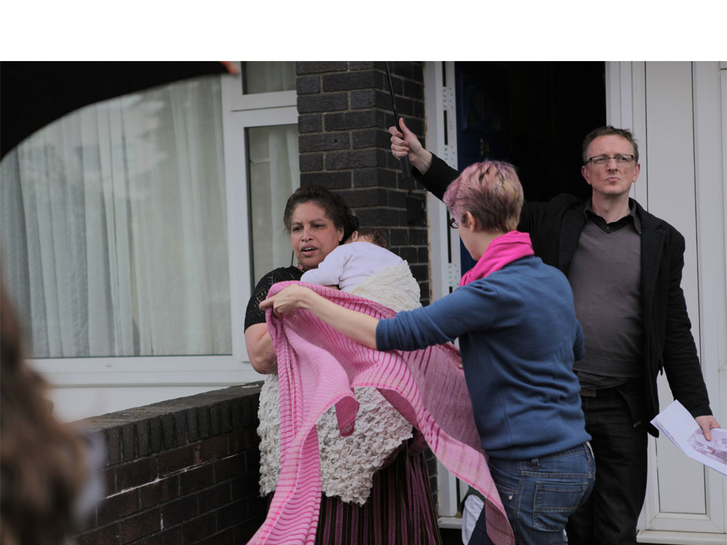<i><b>Image:</b></i> <i>Statues</i>, a participatory film project produced by Janet Hodgson with Butetown Residents @Loudoun Square, Butetown, Cardiff, 2012.  Photograph by Victoria Rodway © CCHA